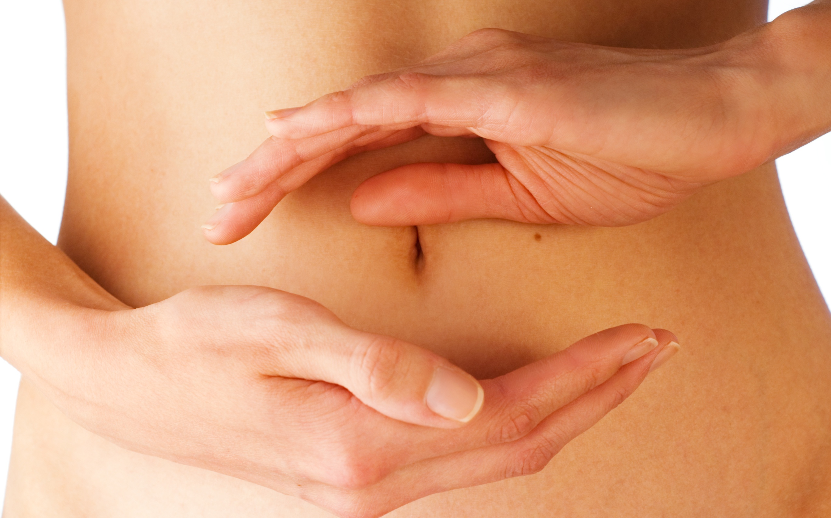women holding her hands in circle shape in front of her stomach